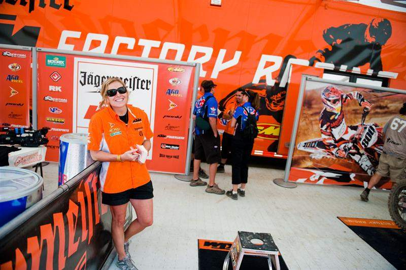 Christy LaCurelle from KTM hanging out in the orange pits.