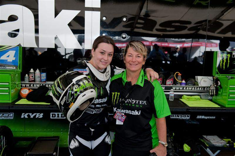 Sara Price (left) hangs with Kawi PR manager Jan Plessner (right) in the Kawasaki pits.