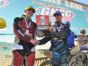 Paul Whibley, last year's GNCC Champ, hands the number-one plate over to Josh Strang.