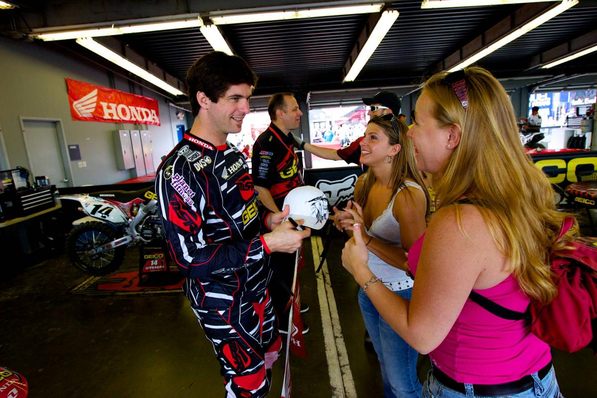 Kevin Windham gives an autograph to some happy fans