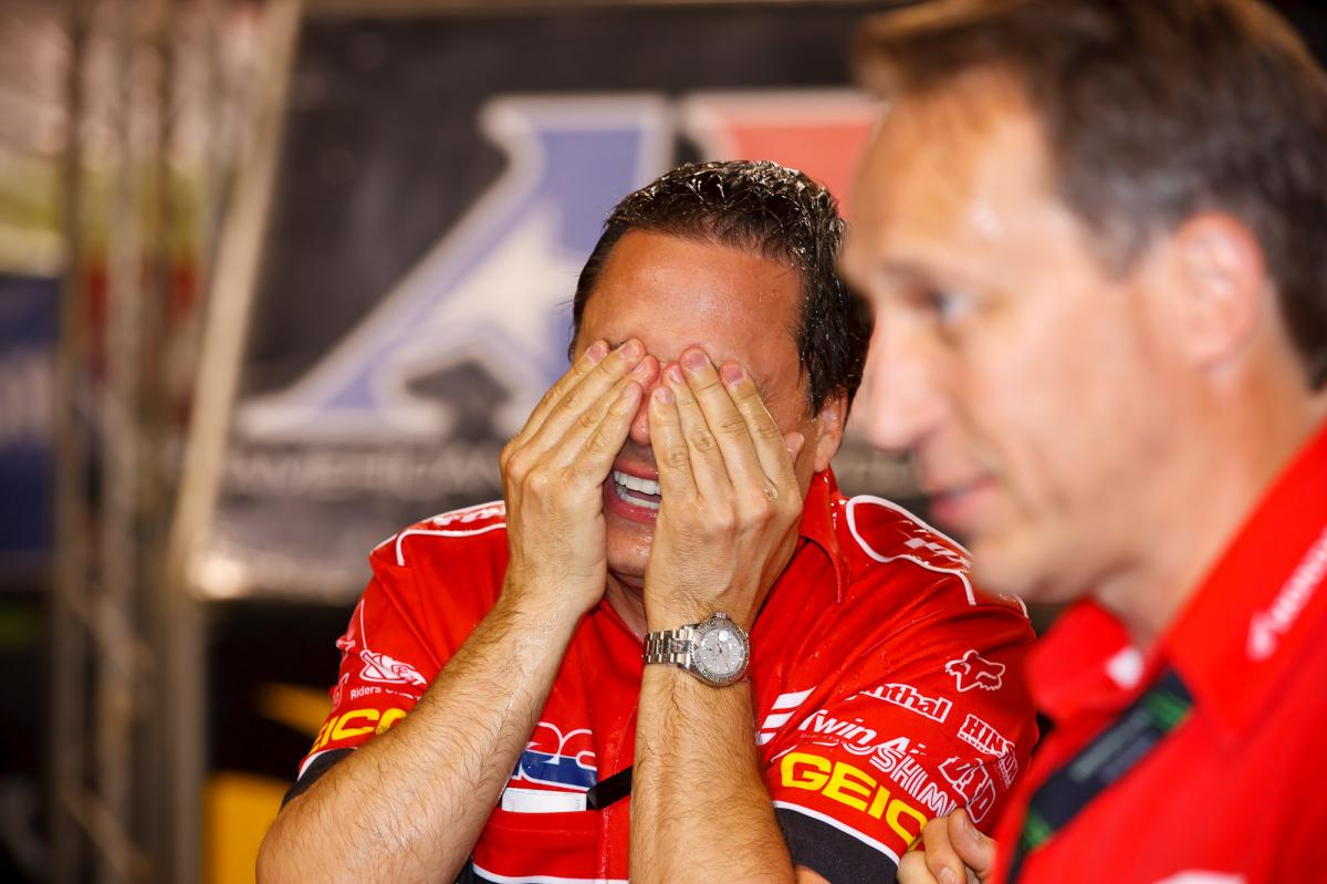 Honda's Bill Savino gets a champagne eye wash