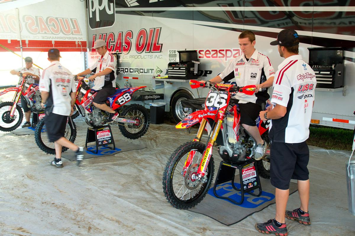 Cole Seely, Travis Baker, and the TLD Honda team getting their bikes dialed in.