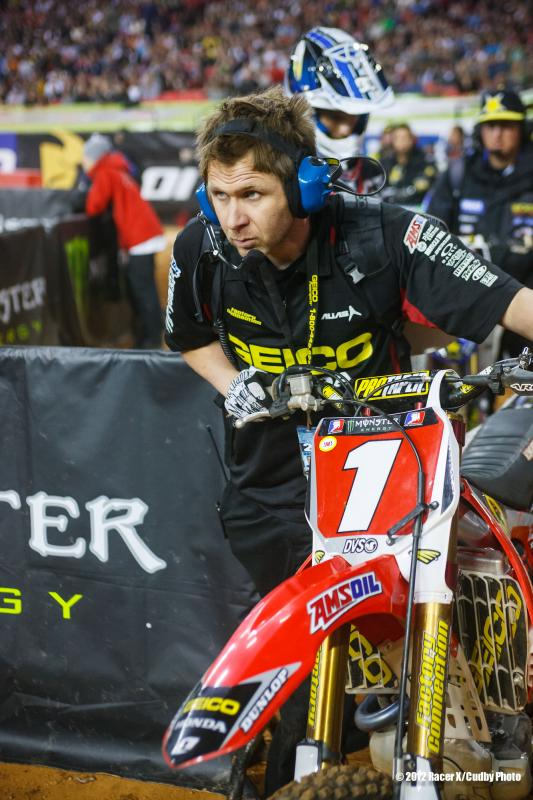 Schnikey rolls Barcia's bike to the start