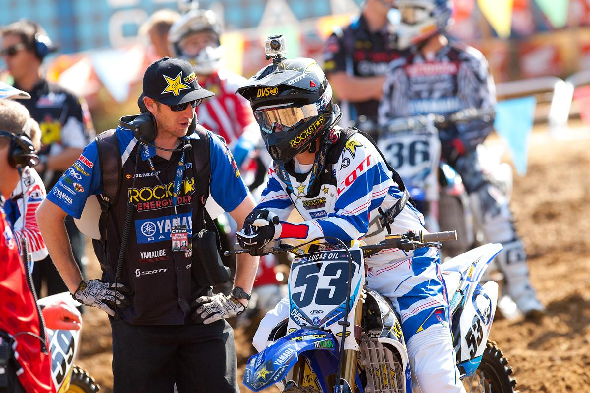 Ryan Sipes talks with his mechanic.