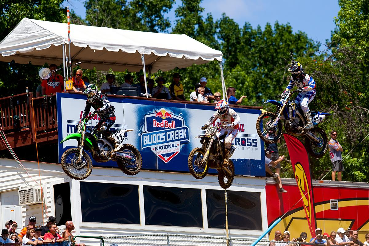 Weimer, Friese, Sipes over the finish line jump after the start.