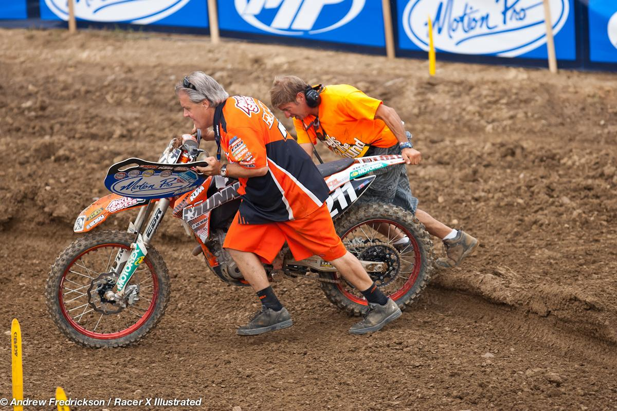 Tevin Tapia's bike pushed off after a crash.