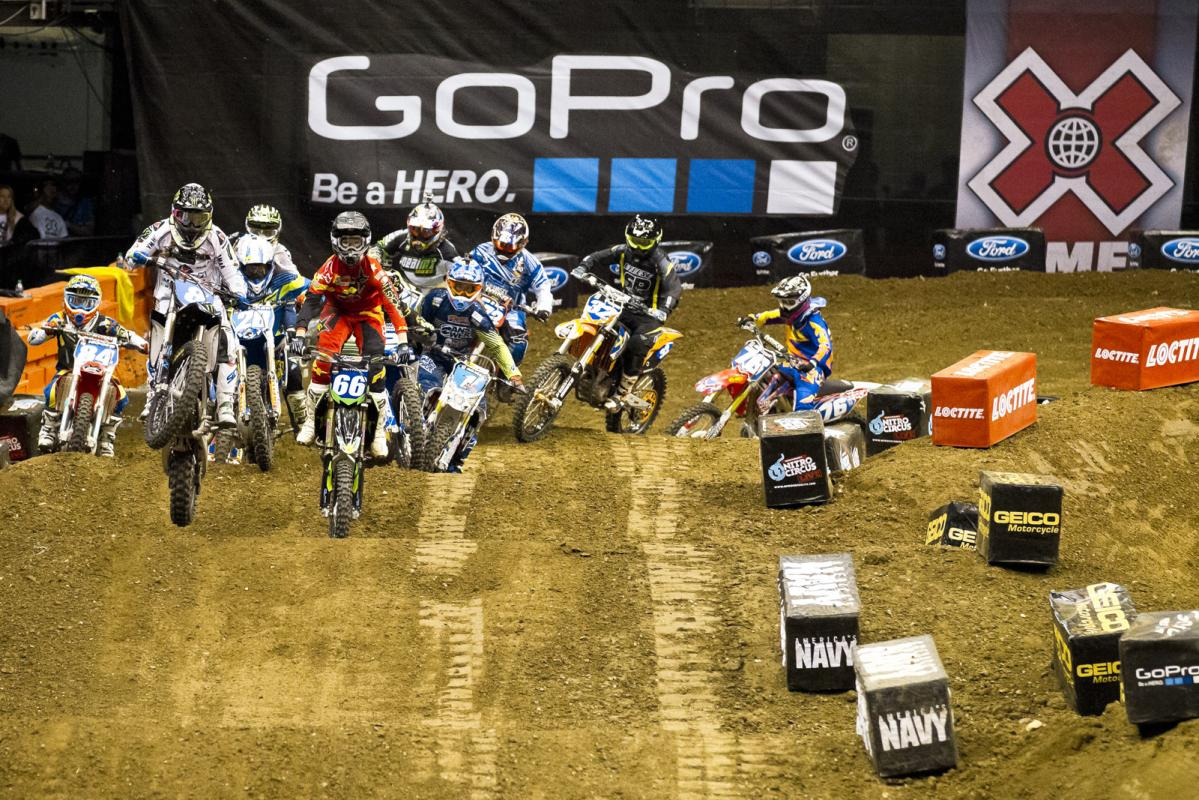 The Women's Moto X Finals gets underway with Italian rider Kiara Fontanesi grabbing the holeshot and leading the 12-rider pack down the first rhythm section.