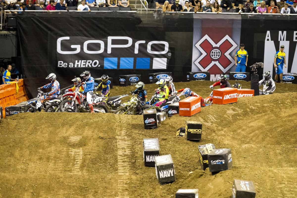 A tiny track with an even tinier start straight wound up spelling chaos for Chad Reed and others as the pack swung wide in the first turn. Josh Hill seized the opportunity and dove under them all to grab the all-important holeshot.