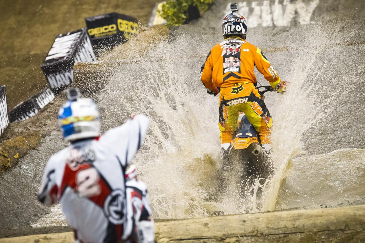 Taddy Blazusiak splashes through a massive water section, one of several challenging obstacles on the course. Amazingly enough, the entire circuit is built overnight after the Moto X racing, and features two water pools, several rocks and logs, and even step-ups and double jumps.