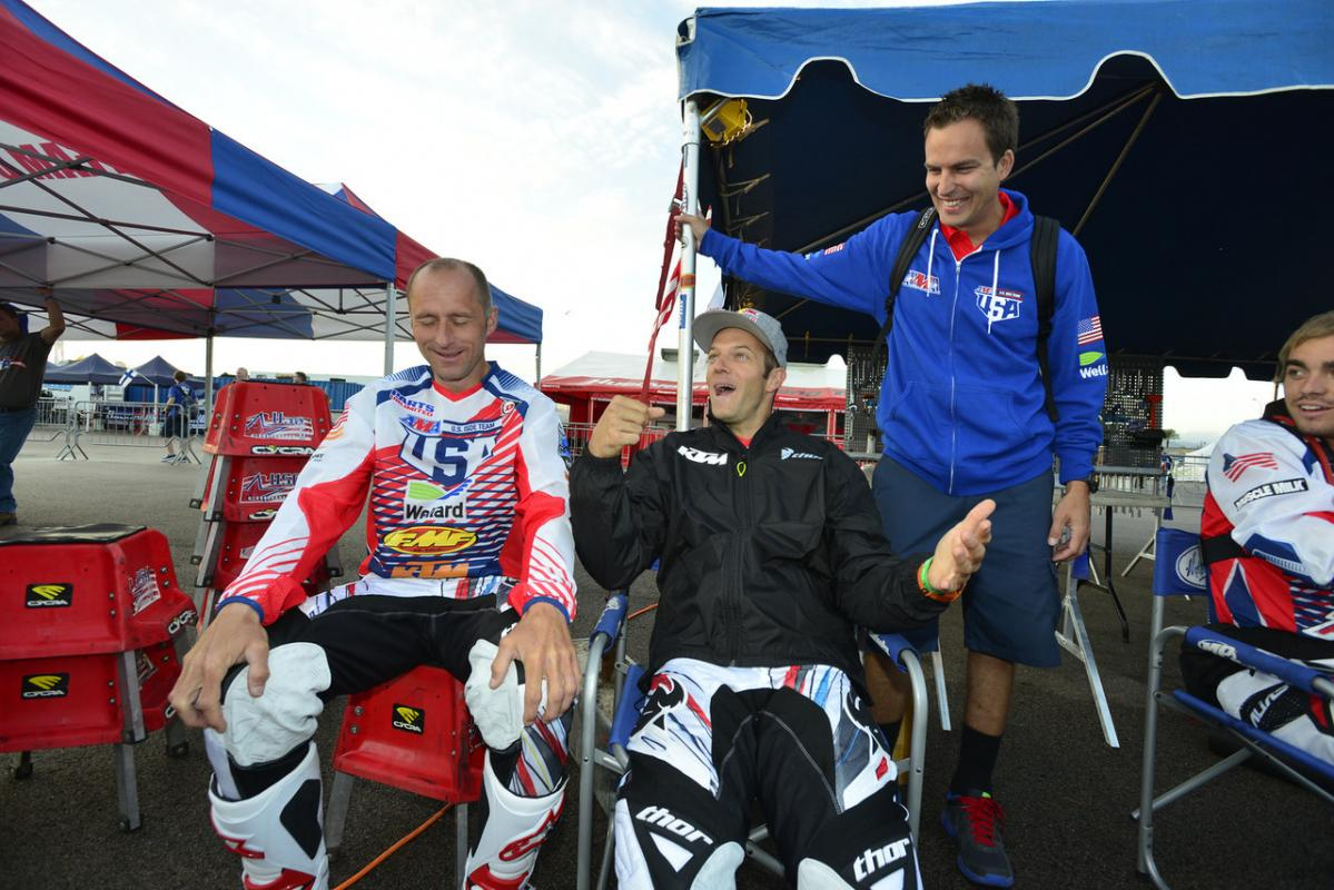 Kurt Caselli jokes around with teammate Mike Brown and US Team manager Antti Kallonen before the start of Day-one at this years ISDE.