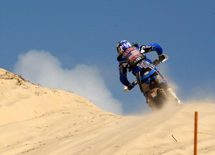 US Junior Trophy Team rider Kurt Caselli crests a sand dune during the 2003 ISDE held in Brazil where he finished