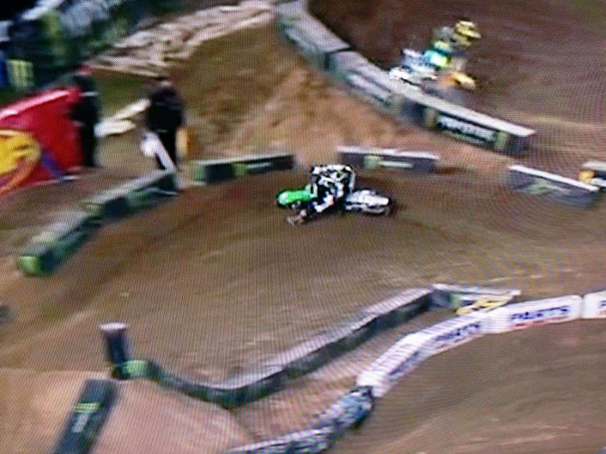 Chad is far to the left coming into the berm so he has to make an extremely sharp turn. This sharp angle causes him to slow considerably and rely on the far outside line to make his arc.