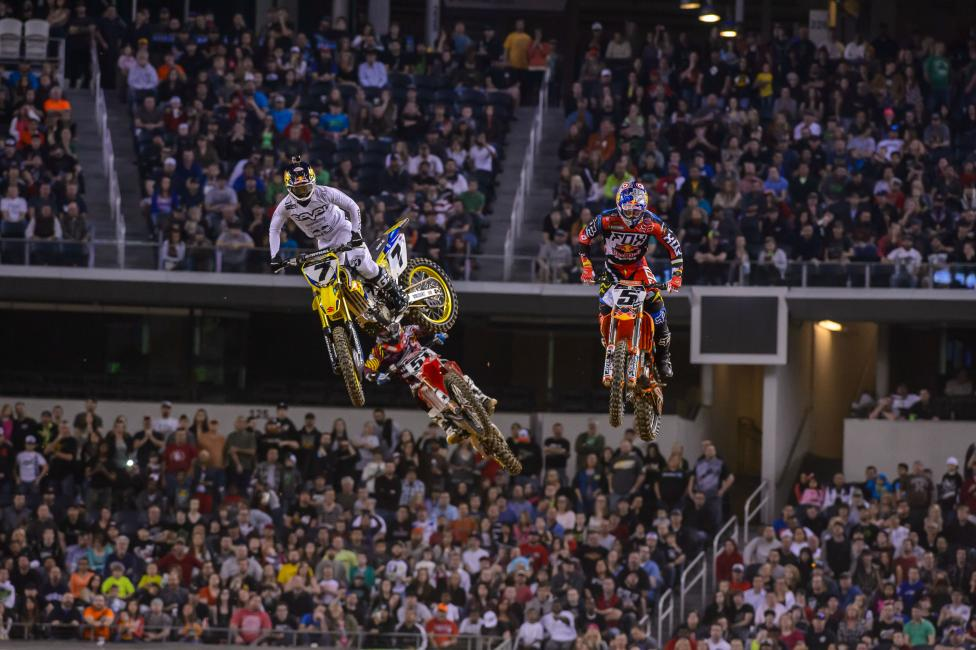 James Stewart (7) used the rhythm section after the finish line to distance himself from Ryan Dungey (5). Photo: Simon Cudby