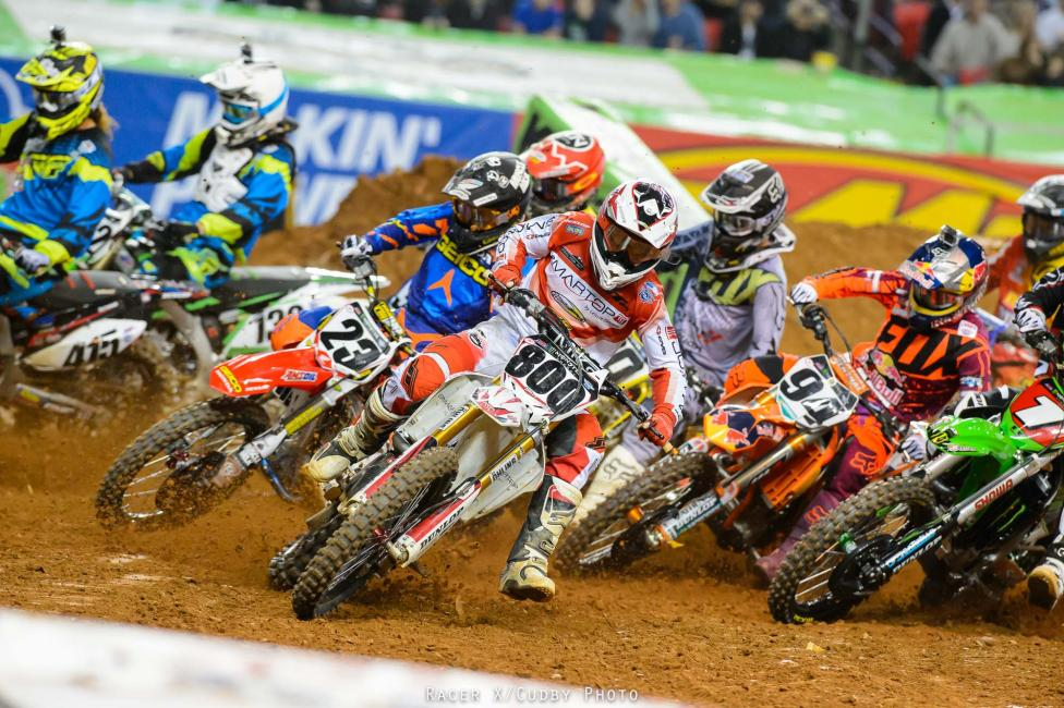 Holeshot artist Mike Alessi was back in form tonight. The MotoConcepts rider led James Stewart, Ryan Villopoto, Ken Roczen and Ryan Dungey into the first turn, but Stewart didn't hold second for long.