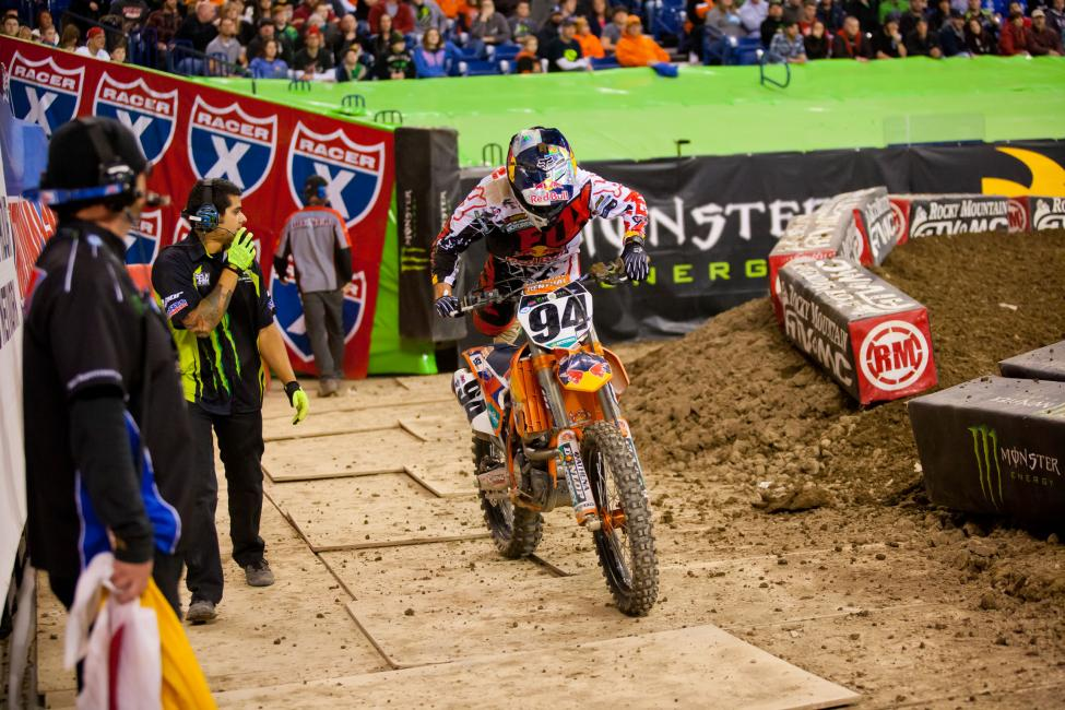 With Dungey out front, the championship aspirations of Ken Roczen took a giant hit. Following the first turn crash, Roczen had worked his way eleventh before another huge crash left him on the ground. Roczen tried to return, but was unable to finish. He finished the night 21st. Points leader Ryan Villopoto was taking a different approach, picking off riders left and right, eventually working his way up to fourth, salvaging a ton of points on a tough night. James Stewart was never in contention after the first turn, finishing the night seventh. With Ryan Dungey walking away with his first win, Eli Tomac and Mike Alessi were left to battle for second. And for a while, it looked like Alessi was going to hold on for his first podium since 2009 until he cross rutted on the tough rhythm section before the triple and left second for Tomac. Cole Seely, in his fill-in ride for Honda Muscle Milk, was strong all night. Seely would round out the podium—a career first. Ryan Dungey celebrates his first win of the season. Factory Metal Works/Club MX's Vince Friese would lead the 250SX class around the first corner, grabbing the holeshot over Monster Energy/Pro Circuit teammates Adam Cianciarulo and Martin Davalos. Davalos would quickly shoot into the lead, with Cianciarulo tow. Davalos opened up a quick gap, but a costly mistake in a deep rut—than went down to the plywood—left Martin scrambling to regain the lead. Cianciarulo took full advantage, until a costly mistake of his own let GEICO rookie Matt Bisceglia to close in. But Cianciarulo was able to use the quad to his advantage—the only 250 rider we saw hitting it—to open back up the lead, leading to his second win of the season. Bisceglia would eventually fall back to finish fourth—a career high for the rookie. GEICO Honda's Justin Bogle overcame another lackluster start to charge back and capture his second straight podium.450SX Overall1. R. Dungey2. E. Tomac3. C. Seely4. R. Villopoto5. B. Tickle6. A. Short7. J. Stewart8. J. Brayton9. J. Hill10. D. Wilson11. W. Hahn12. J. Grant13. N. Wey14. C. Blose15. M. Alessi16. K. Chisholm17. J. Albertson18. C. Gilmore19. N. Schmidt20. R. Stewart21. K. Roczen22. W. Peick450SX Class Season StandingsRyan Villopoto, Poulsbo, Wash., Kawasaki, 184Ryan Dungey, Belle Plaine, Minn., KTM, 161Ken Roczen, Murrieta, Calif., KTM, 158James Stewart, Haines City, Fla., Suzuki, 154Justin Brayton, Cornelius, N.C., 143Chad Reed, Dade City, Fla., Kawasaki, 111Justin Barcia, Pinetta, Fla., Honda, 109Andrew Short, Smithville, Texas, KTM, 109Wil Hahn, Menifee, Calif., Honda, 93Broc Tickle, Holly, Mich., Suzuki, 93250SX Overall1. A. Cianciarulo2. M. Davalos3. J. Bogle4. M. Bisceglia5. B. Baggett6. V. Friese7. J. Decotis8. M. Lemoine9. C. Thompson10. K. Cunningham11. A. Martin12. K. Peters13. M. Oldenburg14. A. Catanzaro15. J. Richardson16. J. Starling17. B. Nauditt18. J. Owen19. J. Martin20. B. Wharton21. P. Coates22. G. Faith Eastern Regional 250SX Class Season StandingsAdam Cianciarulo, Port Orange, Fla., Kawasaki, 72Martin Davalos, Cairo, Ga., Kawasaki, 67Justin Bogle, Cushing, Okla., Honda, 56Blake Baggett, Grand Terrace, Calif., Kawasaki, 54Vince Friese, Cape Girardeau, Mo., Honda, 48Cole Thompson, Brigden, Canada, KTM, 40James Decotis, Peabody, Mass., Honda, 34Blake Wharton, Beaumont, Texas, Honda, 33Kyle Cunningham, Aledo, Texas, Honda, 33Mitchell Oldenburg, Alvord, Texas, Honda, 30Photo: photographerPhoto: photographerPoints leader Ryan Villopoto was taking a different approach, picking off riders left and right, eventually working his way up to fourth, salvaging a ton of points on a tough night. James Stewart was never in contention after the first turn, finishing the night seventh. With Ryan Dungey walking away with his first win, Eli Tomac and Mike Alessi were left to battle for second. And for a while, it looked like Alessi was going to hold on for his first podium since 2009 until he cross rutted on the tough rhythm section before the triple and left second for Tomac. Cole Seely, in his fill-in ride for Honda Muscle Milk, was strong all night. Seely would round out the podium—a career first. Ryan Dungey celebrates his first win of the season. Factory Metal Works/Club MX's Vince Friese would lead the 250SX class around the first corner, grabbing the holeshot over Monster Energy/Pro Circuit teammates Adam Cianciarulo and Martin Davalos. Davalos would quickly shoot into the lead, with Cianciarulo tow. Davalos opened up a quick gap, but a costly mistake in a deep rut—than went down to the plywood—left Martin scrambling to regain the lead. Cianciarulo took full advantage, until a costly mistake of his own let GEICO rookie Matt Bisceglia to close in. But Cianciarulo was able to use the quad to his advantage—the only 250 rider we saw hitting it—to open back up the lead, leading to his second win of the season. Bisceglia would eventually fall back to finish fourth—a career high for the rookie. GEICO Honda's Justin Bogle overcame another lackluster start to charge back and capture his second straight podium.450SX Overall1. R. Dungey2. E. Tomac3. C. Seely4. R. Villopoto5. B. Tickle6. A. Short7. J. Stewart8. J. Brayton9. J. Hill10. D. Wilson11. W. Hahn12. J. Grant13. N. Wey14. C. Blose15. M. Alessi16. K. Chisholm17. J. Albertson18. C. Gilmore19. N. Schmidt20. R. Stewart21. K. Roczen22. W. Peick450SX Class Season StandingsRyan Villopoto, Poulsbo, Wash., Kawasaki, 184Ryan Dungey, Belle Plaine, Minn., KTM, 161Ken Roczen, Murrieta, Calif., KTM, 158James Stewart, Haines City, Fla., Suzuki, 154Justin Brayton, Cornelius, N.C., 143Chad Reed, Dade City, Fla., Kawasaki, 111Justin Barcia, Pinetta, Fla., Honda, 109Andrew Short, Smithville, Texas, KTM, 109Wil Hahn, Menifee, Calif., Honda, 93Broc Tickle, Holly, Mich., Suzuki, 93250SX Overall1. A. Cianciarulo2. M. Davalos3. J. Bogle4. M. Bisceglia5. B. Baggett6. V. Friese7. J. Decotis8. M. Lemoine9. C. Thompson10. K. Cunningham11. A. Martin12. K. Peters13. M. Oldenburg14. A. Catanzaro15. J. Richardson16. J. Starling17. B. Nauditt18. J. Owen19. J. Martin20. B. Wharton21. P. Coates22. G. Faith Eastern Regional 250SX Class Season StandingsAdam Cianciarulo, Port Orange, Fla., Kawasaki, 72Martin Davalos, Cairo, Ga., Kawasaki, 67Justin Bogle, Cushing, Okla., Honda, 56Blake Baggett, Grand Terrace, Calif., Kawasaki, 54Vince Friese, Cape Girardeau, Mo., Honda, 48Cole Thompson, Brigden, Canada, KTM, 40James Decotis, Peabody, Mass., Honda, 34Blake Wharton, Beaumont, Texas, Honda, 33Kyle Cunningham, Aledo, Texas, Honda, 33Mitchell Oldenburg, Alvord, Texas, Honda, 30Photo: photographerPhoto: photographerJames Stewart was never in contention after the first turn, finishing the night seventh. With Ryan Dungey walking away with his first win, Eli Tomac and Mike Alessi were left to battle for second. And for a while, it looked like Alessi was going to hold on for his first podium since 2009 until he cross rutted on the tough rhythm section before the triple and left second for Tomac. Cole Seely, in his fill-in ride for Honda Muscle Milk, was strong all night. Seely would round out the podium—a career first. Ryan Dungey celebrates his first win of the season. Factory Metal Works/Club MX's Vince Friese would lead the 250SX class around the first corner, grabbing the holeshot over Monster Energy/Pro Circuit teammates Adam Cianciarulo and Martin Davalos. Davalos would quickly shoot into the lead, with Cianciarulo tow. Davalos opened up a quick gap, but a costly mistake in a deep rut—than went down to the plywood—left Martin scrambling to regain the lead. Cianciarulo took full advantage, until a costly mistake of his own let GEICO rookie Matt Bisceglia to close in. But Cianciarulo was able to use the quad to his advantage—the only 250 rider we saw hitting it—to open back up the lead, leading to his second win of the season. Bisceglia would eventually fall back to finish fourth—a career high for the rookie. GEICO Honda's Justin Bogle overcame another lackluster start to charge back and capture his second straight podium.450SX Overall1. R. Dungey2. E. Tomac3. C. Seely4. R. Villopoto5. B. Tickle6. A. Short7. J. Stewart8. J. Brayton9. J. Hill10. D. Wilson11. W. Hahn12. J. Grant13. N. Wey14. C. Blose15. M. Alessi16. K. Chisholm17. J. Albertson18. C. Gilmore19. N. Schmidt20. R. Stewart21. K. Roczen22. W. Peick450SX Class Season StandingsRyan Villopoto, Poulsbo, Wash., Kawasaki, 184Ryan Dungey, Belle Plaine, Minn., KTM, 161Ken Roczen, Murrieta, Calif., KTM, 158James Stewart, Haines City, Fla., Suzuki, 154Justin Brayton, Cornelius, N.C., 143Chad Reed, Dade City, Fla., Kawasaki, 111Justin Barcia, Pinetta, Fla., Honda, 109Andrew Short, Smithville, Texas, KTM, 109Wil Hahn, Menifee, Calif., Honda, 93Broc Tickle, Holly, Mich., Suzuki, 93250SX Overall1. A. Cianciarulo2. M. Davalos3. J. Bogle4. M. Bisceglia5. B. Baggett6. V. Friese7. J. Decotis8. M. Lemoine9. C. Thompson10. K. Cunningham11. A. Martin12. K. Peters13. M. Oldenburg14. A. Catanzaro15. J. Richardson16. J. Starling17. B. Nauditt18. J. Owen19. J. Martin20. B. Wharton21. P. Coates22. G. Faith Eastern Regional 250SX Class Season StandingsAdam Cianciarulo, Port Orange, Fla., Kawasaki, 72Martin Davalos, Cairo, Ga., Kawasaki, 67Justin Bogle, Cushing, Okla., Honda, 56Blake Baggett, Grand Terrace, Calif., Kawasaki, 54Vince Friese, Cape Girardeau, Mo., Honda, 48Cole Thompson, Brigden, Canada, KTM, 40James Decotis, Peabody, Mass., Honda, 34Blake Wharton, Beaumont, Texas, Honda, 33Kyle Cunningham, Aledo, Texas, Honda, 33Mitchell Oldenburg, Alvord, Texas, Honda, 30Photo: photographerPhoto: photographerWith Ryan Dungey walking away with his first win, Eli Tomac and Mike Alessi were left to battle for second. And for a while, it looked like Alessi was going to hold on for his first podium since 2009 until he cross rutted on the tough rhythm section before the triple and left second for Tomac. Cole Seely, in his fill-in ride for Honda Muscle Milk, was strong all night. Seely would round out the podium—a career first. Ryan Dungey celebrates his first win of the season. Factory Metal Works/Club MX's Vince Friese would lead the 250SX class around the first corner, grabbing the holeshot over Monster Energy/Pro Circuit teammates Adam Cianciarulo and Martin Davalos. Davalos would quickly shoot into the lead, with Cianciarulo tow. Davalos opened up a quick gap, but a costly mistake in a deep rut—than went down to the plywood—left Martin scrambling to regain the lead. Cianciarulo took full advantage, until a costly mistake of his own let GEICO rookie Matt Bisceglia to close in. But Cianciarulo was able to use the quad to his advantage—the only 250 rider we saw hitting it—to open back up the lead, leading to his second win of the season. Bisceglia would eventually fall back to finish fourth—a career high for the rookie. GEICO Honda's Justin Bogle overcame another lackluster start to charge back and capture his second straight podium.450SX Overall1. R. Dungey2. E. Tomac3. C. Seely4. R. Villopoto5. B. Tickle6. A. Short7. J. Stewart8. J. Brayton9. J. Hill10. D. Wilson11. W. Hahn12. J. Grant13. N. Wey14. C. Blose15. M. Alessi16. K. Chisholm17. J. Albertson18. C. Gilmore19. N. Schmidt20. R. Stewart21. K. Roczen22. W. Peick450SX Class Season StandingsRyan Villopoto, Poulsbo, Wash., Kawasaki, 184Ryan Dungey, Belle Plaine, Minn., KTM, 161Ken Roczen, Murrieta, Calif., KTM, 158James Stewart, Haines City, Fla., Suzuki, 154Justin Brayton, Cornelius, N.C., 143Chad Reed, Dade City, Fla., Kawasaki, 111Justin Barcia, Pinetta, Fla., Honda, 109Andrew Short, Smithville, Texas, KTM, 109Wil Hahn, Menifee, Calif., Honda, 93Broc Tickle, Holly, Mich., Suzuki, 93250SX Overall1. A. Cianciarulo2. M. Davalos3. J. Bogle4. M. Bisceglia5. B. Baggett6. V. Friese7. J. Decotis8. M. Lemoine9. C. Thompson10. K. Cunningham11. A. Martin12. K. Peters13. M. Oldenburg14. A. Catanzaro15. J. Richardson16. J. Starling17. B. Nauditt18. J. Owen19. J. Martin20. B. Wharton21. P. Coates22. G. Faith Eastern Regional 250SX Class Season StandingsAdam Cianciarulo, Port Orange, Fla., Kawasaki, 72Martin Davalos, Cairo, Ga., Kawasaki, 67Justin Bogle, Cushing, Okla., Honda, 56Blake Baggett, Grand Terrace, Calif., Kawasaki, 54Vince Friese, Cape Girardeau, Mo., Honda, 48Cole Thompson, Brigden, Canada, KTM, 40James Decotis, Peabody, Mass., Honda, 34Blake Wharton, Beaumont, Texas, Honda, 33Kyle Cunningham, Aledo, Texas, Honda, 33Mitchell Oldenburg, Alvord, Texas, Honda, 30Photo: photographerPhoto: photographerCole Seely, in his fill-in ride for Honda Muscle Milk, was strong all night. Seely would round out the podium—a career first. Ryan Dungey celebrates his first win of the season. Factory Metal Works/Club MX's Vince Friese would lead the 250SX class around the first corner, grabbing the holeshot over Monster Energy/Pro Circuit teammates Adam Cianciarulo and Martin Davalos. Davalos would quickly shoot into the lead, with Cianciarulo tow. Davalos opened up a quick gap, but a costly mistake in a deep rut—than went down to the plywood—left Martin scrambling to regain the lead. Cianciarulo took full advantage, until a costly mistake of his own let GEICO rookie Matt Bisceglia to close in. But Cianciarulo was able to use the quad to his advantage—the only 250 rider we saw hitting it—to open back up the lead, leading to his second win of the season. Bisceglia would eventually fall back to finish fourth—a career high for the rookie. GEICO Honda's Justin Bogle overcame another lackluster start to charge back and capture his second straight podium.450SX Overall1. R. Dungey2. E. Tomac3. C. Seely4. R. Villopoto5. B. Tickle6. A. Short7. J. Stewart8. J. Brayton9. J. Hill10. D. Wilson11. W. Hahn12. J. Grant13. N. Wey14. C. Blose15. M. Alessi16. K. Chisholm17. J. Albertson18. C. Gilmore19. N. Schmidt20. R. Stewart21. K. Roczen22. W. Peick450SX Class Season StandingsRyan Villopoto, Poulsbo, Wash., Kawasaki, 184Ryan Dungey, Belle Plaine, Minn., KTM, 161Ken Roczen, Murrieta, Calif., KTM, 158James Stewart, Haines City, Fla., Suzuki, 154Justin Brayton, Cornelius, N.C., 143Chad Reed, Dade City, Fla., Kawasaki, 111Justin Barcia, Pinetta, Fla., Honda, 109Andrew Short, Smithville, Texas, KTM, 109Wil Hahn, Menifee, Calif., Honda, 93Broc Tickle, Holly, Mich., Suzuki, 93250SX Overall1. A. Cianciarulo2. M. Davalos3. J. Bogle4. M. Bisceglia5. B. Baggett6. V. Friese7. J. Decotis8. M. Lemoine9. C. Thompson10. K. Cunningham11. A. Martin12. K. Peters13. M. Oldenburg14. A. Catanzaro15. J. Richardson16. J. Starling17. B. Nauditt18. J. Owen19. J. Martin20. B. Wharton21. P. Coates22. G. Faith Eastern Regional 250SX Class Season StandingsAdam Cianciarulo, Port Orange, Fla., Kawasaki, 72Martin Davalos, Cairo, Ga., Kawasaki, 67Justin Bogle, Cushing, Okla., Honda, 56Blake Baggett, Grand Terrace, Calif., Kawasaki, 54Vince Friese, Cape Girardeau, Mo., Honda, 48Cole Thompson, Brigden, Canada, KTM, 40James Decotis, Peabody, Mass., Honda, 34Blake Wharton, Beaumont, Texas, Honda, 33Kyle Cunningham, Aledo, Texas, Honda, 33Mitchell Oldenburg, Alvord, Texas, Honda, 30Photo: photographerPhoto: photographerRyan Dungey celebrates his first win of the season.Factory Metal Works/Club MX's Vince Friese would lead the 250SX class around the first corner, grabbing the holeshot over Monster Energy/Pro Circuit teammates Adam Cianciarulo and Martin Davalos. Davalos would quickly shoot into the lead, with Cianciarulo tow. Davalos opened up a quick gap, but a costly mistake in a deep rut—than went down to the plywood—left Martin scrambling to regain the lead. Cianciarulo took full advantage, until a costly mistake of his own let GEICO rookie Matt Bisceglia to close in. But Cianciarulo was able to use the quad to his advantage—the only 250 rider we saw hitting it—to open back up the lead, leading to his second win of the season. Bisceglia would eventually fall back to finish fourth—a career high for the rookie. GEICO Honda's Justin Bogle overcame another lackluster start to charge back and capture his second straight podium.450SX Overall1. R. Dungey2. E. Tomac3. C. Seely4. R. Villopoto5. B. Tickle6. A. Short7. J. Stewart8. J. Brayton9. J. Hill10. D. Wilson11. W. Hahn12. J. Grant13. N. Wey14. C. Blose15. M. Alessi16. K. Chisholm17. J. Albertson18. C. Gilmore19. N. Schmidt20. R. Stewart21. K. Roczen22. W. Peick450SX Class Season StandingsRyan Villopoto, Poulsbo, Wash., Kawasaki, 184Ryan Dungey, Belle Plaine, Minn., KTM, 161Ken Roczen, Murrieta, Calif., KTM, 158James Stewart, Haines City, Fla., Suzuki, 154Justin Brayton, Cornelius, N.C., 143Chad Reed, Dade City, Fla., Kawasaki, 111Justin Barcia, Pinetta, Fla., Honda, 109Andrew Short, Smithville, Texas, KTM, 109Wil Hahn, Menifee, Calif., Honda, 93Broc Tickle, Holly, Mich., Suzuki, 93250SX Overall1. A. Cianciarulo2. M. Davalos3. J. Bogle4. M. Bisceglia5. B. Baggett6. V. Friese7. J. Decotis8. M. Lemoine9. C. Thompson10. K. Cunningham11. A. Martin12. K. Peters13. M. Oldenburg14. A. Catanzaro15. J. Richardson16. J. Starling17. B. Nauditt18. J. Owen19. J. Martin20. B. Wharton21. P. Coates22. G. Faith Eastern Regional 250SX Class Season StandingsAdam Cianciarulo, Port Orange, Fla., Kawasaki, 72Martin Davalos, Cairo, Ga., Kawasaki, 67Justin Bogle, Cushing, Okla., Honda, 56Blake Baggett, Grand Terrace, Calif., Kawasaki, 54Vince Friese, Cape Girardeau, Mo., Honda, 48Cole Thompson, Brigden, Canada, KTM, 40James Decotis, Peabody, Mass., Honda, 34Blake Wharton, Beaumont, Texas, Honda, 33Kyle Cunningham, Aledo, Texas, Honda, 33Mitchell Oldenburg, Alvord, Texas, Honda, 30Photo: photographerPhoto: photographerDavalos would quickly shoot into the lead, with Cianciarulo tow. Davalos opened up a quick gap, but a costly mistake in a deep rut—than went down to the plywood—left Martin scrambling to regain the lead. Cianciarulo took full advantage, until a costly mistake of his own let GEICO rookie Matt Bisceglia to close in. But Cianciarulo was able to use the quad to his advantage—the only 250 rider we saw hitting it—to open back up the lead, leading to his second win of the season. Bisceglia would eventually fall back to finish fourth—a career high for the rookie. GEICO Honda's Justin Bogle overcame another lackluster start to charge back and capture his second straight podium.450SX Overall1. R. Dungey2. E. Tomac3. C. Seely4. R. Villopoto5. B. Tickle6. A. Short7. J. Stewart8. J. Brayton9. J. Hill10. D. Wilson11. W. Hahn12. J. Grant13. N. Wey14. C. Blose15. M. Alessi16. K. Chisholm17. J. Albertson18. C. Gilmore19. N. Schmidt20. R. Stewart21. K. Roczen22. W. Peick450SX Class Season StandingsRyan Villopoto, Poulsbo, Wash., Kawasaki, 184Ryan Dungey, Belle Plaine, Minn., KTM, 161Ken Roczen, Murrieta, Calif., KTM, 158James Stewart, Haines City, Fla., Suzuki, 154Justin Brayton, Cornelius, N.C., 143Chad Reed, Dade City, Fla., Kawasaki, 111Justin Barcia, Pinetta, Fla., Honda, 109Andrew Short, Smithville, Texas, KTM, 109Wil Hahn, Menifee, Calif., Honda, 93Broc Tickle, Holly, Mich., Suzuki, 93250SX Overall1. A. Cianciarulo2. M. Davalos3. J. Bogle4. M. Bisceglia5. B. Baggett6. V. Friese7. J. Decotis8. M. Lemoine9. C. Thompson10. K. Cunningham11. A. Martin12. K. Peters13. M. Oldenburg14. A. Catanzaro15. J. Richardson16. J. Starling17. B. Nauditt18. J. Owen19. J. Martin20. B. Wharton21. P. Coates22. G. Faith Eastern Regional 250SX Class Season StandingsAdam Cianciarulo, Port Orange, Fla., Kawasaki, 72Martin Davalos, Cairo, Ga., Kawasaki, 67Justin Bogle, Cushing, Okla., Honda, 56Blake Baggett, Grand Terrace, Calif., Kawasaki, 54Vince Friese, Cape Girardeau, Mo., Honda, 48Cole Thompson, Brigden, Canada, KTM, 40James Decotis, Peabody, Mass., Honda, 34Blake Wharton, Beaumont, Texas, Honda, 33Kyle Cunningham, Aledo, Texas, Honda, 33Mitchell Oldenburg, Alvord, Texas, Honda, 30Photo: photographerPhoto: photographerCianciarulo took full advantage, until a costly mistake of his own let GEICO rookie Matt Bisceglia to close in. But Cianciarulo was able to use the quad to his advantage—the only 250 rider we saw hitting it—to open back up the lead, leading to his second win of the season. Bisceglia would eventually fall back to finish fourth—a career high for the rookie. GEICO Honda's Justin Bogle overcame another lackluster start to charge back and capture his second straight podium.450SX Overall1. R. Dungey2. E. Tomac3. C. Seely4. R. Villopoto5. B. Tickle6. A. Short7. J. Stewart8. J. Brayton9. J. Hill10. D. Wilson11. W. Hahn12. J. Grant13. N. Wey14. C. Blose15. M. Alessi16. K. Chisholm17. J. Albertson18. C. Gilmore19. N. Schmidt20. R. Stewart21. K. Roczen22. W. Peick450SX Class Season StandingsRyan Villopoto, Poulsbo, Wash., Kawasaki, 184Ryan Dungey, Belle Plaine, Minn., KTM, 161Ken Roczen, Murrieta, Calif., KTM, 158James Stewart, Haines City, Fla., Suzuki, 154Justin Brayton, Cornelius, N.C., 143Chad Reed, Dade City, Fla., Kawasaki, 111Justin Barcia, Pinetta, Fla., Honda, 109Andrew Short, Smithville, Texas, KTM, 109Wil Hahn, Menifee, Calif., Honda, 93Broc Tickle, Holly, Mich., Suzuki, 93250SX Overall1. A. Cianciarulo2. M. Davalos3. J. Bogle4. M. Bisceglia5. B. Baggett6. V. Friese7. J. Decotis8. M. Lemoine9. C. Thompson10. K. Cunningham11. A. Martin12. K. Peters13. M. Oldenburg14. A. Catanzaro15. J. Richardson16. J. Starling17. B. Nauditt18. J. Owen19. J. Martin20. B. Wharton21. P. Coates22. G. Faith Eastern Regional 250SX Class Season StandingsAdam Cianciarulo, Port Orange, Fla., Kawasaki, 72Martin Davalos, Cairo, Ga., Kawasaki, 67Justin Bogle, Cushing, Okla., Honda, 56Blake Baggett, Grand Terrace, Calif., Kawasaki, 54Vince Friese, Cape Girardeau, Mo., Honda, 48Cole Thompson, Brigden, Canada, KTM, 40James Decotis, Peabody, Mass., Honda, 34Blake Wharton, Beaumont, Texas, Honda, 33Kyle Cunningham, Aledo, Texas, Honda, 33Mitchell Oldenburg, Alvord, Texas, Honda, 30Photo: photographerPhoto: photographerGEICO Honda's Justin Bogle overcame another lackluster start to charge back and capture his second straight podium.450SX Overall1. R. Dungey2. E. Tomac3. C. Seely4. R. Villopoto5. B. Tickle6. A. Short7. J. Stewart8. J. Brayton9. J. Hill10. D. Wilson11. W. Hahn12. J. Grant13. N. Wey14. C. Blose15. M. Alessi16. K. Chisholm17. J. Albertson18. C. Gilmore19. N. Schmidt20. R. Stewart21. K. Roczen22. W. Peick450SX Class Season StandingsRyan Villopoto, Poulsbo, Wash., Kawasaki, 184Ryan Dungey, Belle Plaine, Minn., KTM, 161Ken Roczen, Murrieta, Calif., KTM, 158James Stewart, Haines City, Fla., Suzuki, 154Justin Brayton, Cornelius, N.C., 143Chad Reed, Dade City, Fla., Kawasaki, 111Justin Barcia, Pinetta, Fla., Honda, 109Andrew Short, Smithville, Texas, KTM, 109Wil Hahn, Menifee, Calif., Honda, 93Broc Tickle, Holly, Mich., Suzuki, 93250SX Overall1. A. Cianciarulo2. M. Davalos3. J. Bogle4. M. Bisceglia5. B. Baggett6. V. Friese7. J. Decotis8. M. Lemoine9. C. Thompson10. K. Cunningham11. A. Martin12. K. Peters13. M. Oldenburg14. A. Catanzaro15. J. Richardson16. J. Starling17. B. Nauditt18. J. Owen19. J. Martin20. B. Wharton21. P. Coates22. G. Faith Eastern Regional 250SX Class Season StandingsAdam Cianciarulo, Port Orange, Fla., Kawasaki, 72Martin Davalos, Cairo, Ga., Kawasaki, 67Justin Bogle, Cushing, Okla., Honda, 56Blake Baggett, Grand Terrace, Calif., Kawasaki, 54Vince Friese, Cape Girardeau, Mo., Honda, 48Cole Thompson, Brigden, Canada, KTM, 40James Decotis, Peabody, Mass., Honda, 34Blake Wharton, Beaumont, Texas, Honda, 33Kyle Cunningham, Aledo, Texas, Honda, 33Mitchell Oldenburg, Alvord, Texas, Honda, 30Photo: photographer