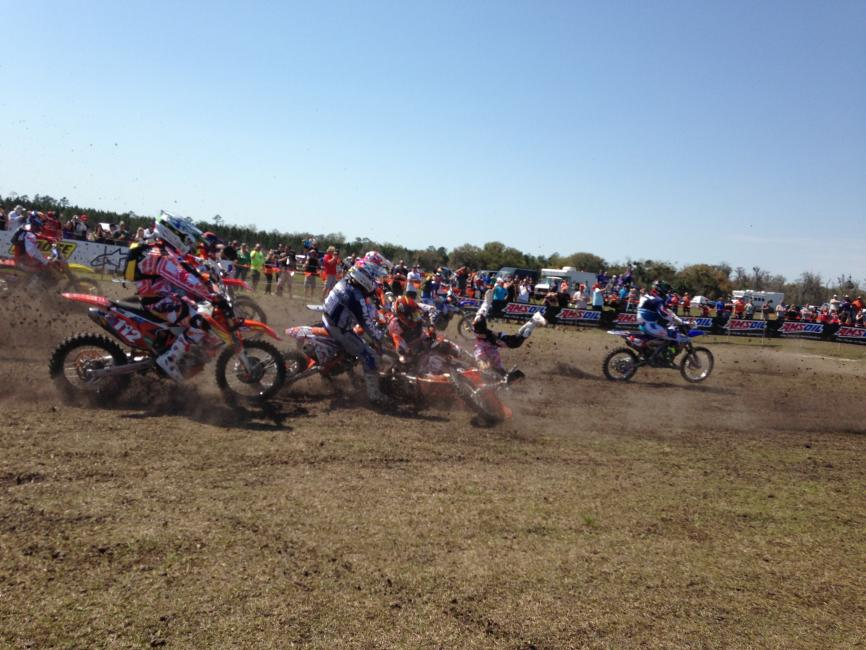 Charlie Mullins got up from this first-turn crash to win the opening round of the 2014 Amsoil GNCC Series in Florida.