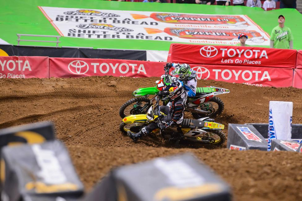 James Stewart passes Ryan Villopoto for the lead en route to the win in St. Louis. Photo: Simon Cudby