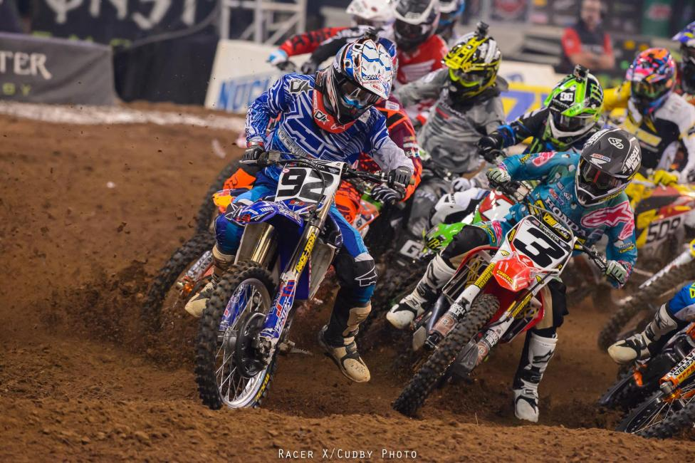 Eli Tomac battles Killy Rusk off the start. Eli was fast in spots but a main event crash hurt his results.Photo: Cudby