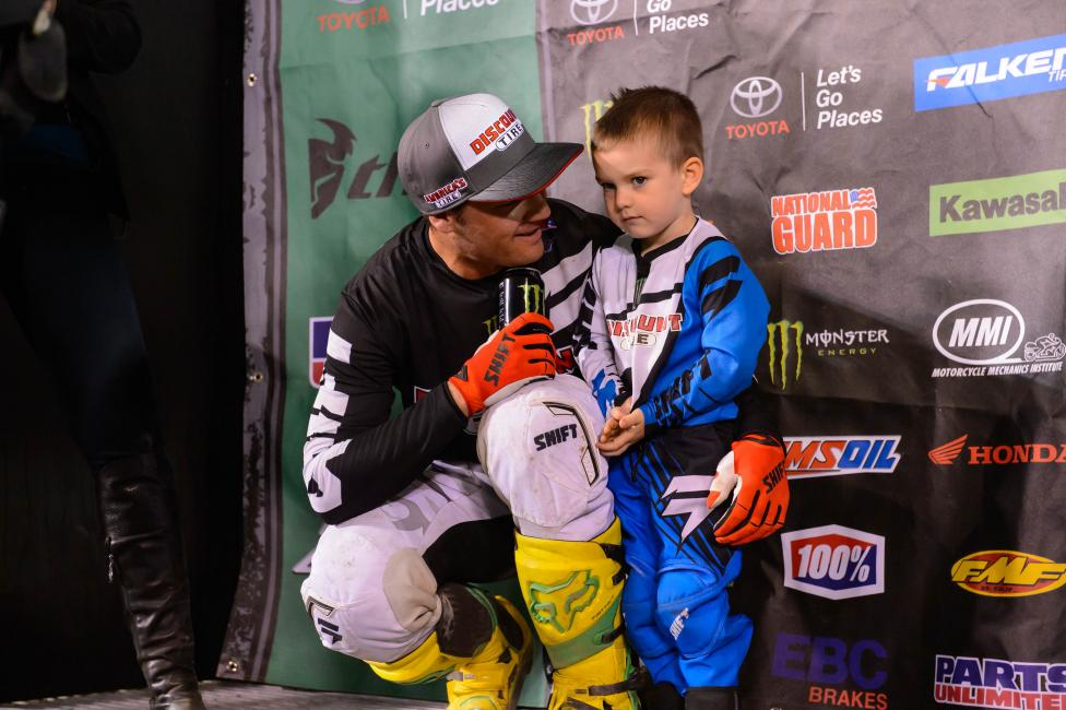 Chad Reed shares a special moment with his son, Tate, after his first win of the season at A2.  Photo: Simon Cudby