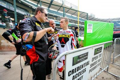 GEICO Honda's Mike LaRocco provides instruction for Zach Bell.