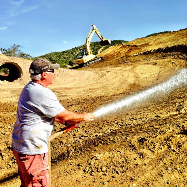 Yes, that's Jody Weisel out there watering.Photo: DC