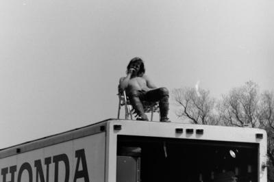 Team Honda's teenaged superstar Marty Smith surveys the crowd from above his box van. He won the first 125 National as well as the '74 championship.