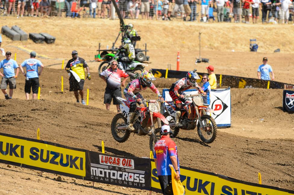 Justin Barcia and Ken Roczen battle for the lead in the second moto of the GoPro Hangtown National last Saturday.  Photo: Simon Cudby