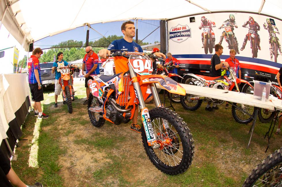 Ken Roczen's mechanic Kelly Lumgair takes his bike through tech today.   Photo: Christian Munoz