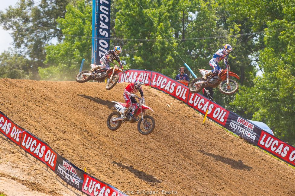 Yeah! Canard, Roczen and Dungey went at it early in moto 1. Roczen passed 'em both and tried to take off, but Dungey hung close.Photo: Cudby