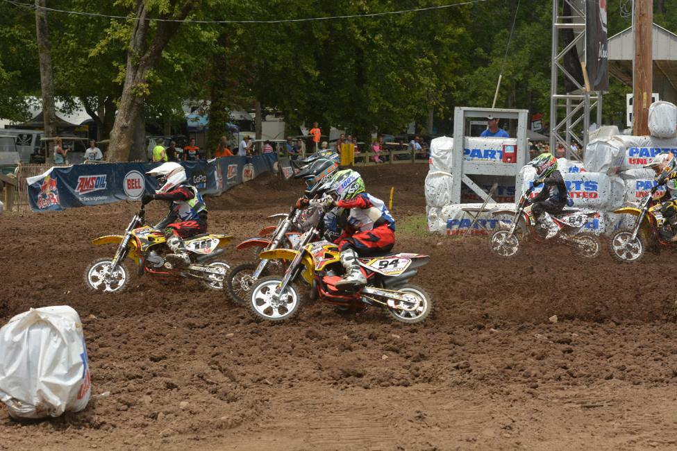 The mini kids battle down the first turn.  Photo: Ken Hill