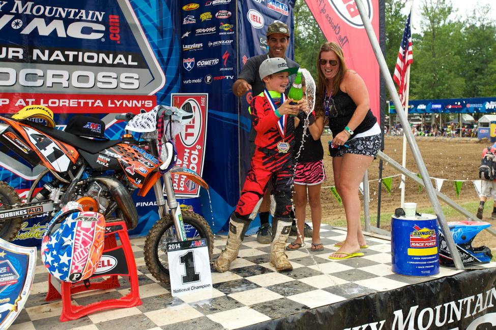 Nick Romano celebrates a 50cc title with family—in this sport, by the time a rider is eight-years-old, they've already got a rep, style, and support.Photo: Christian Munoz