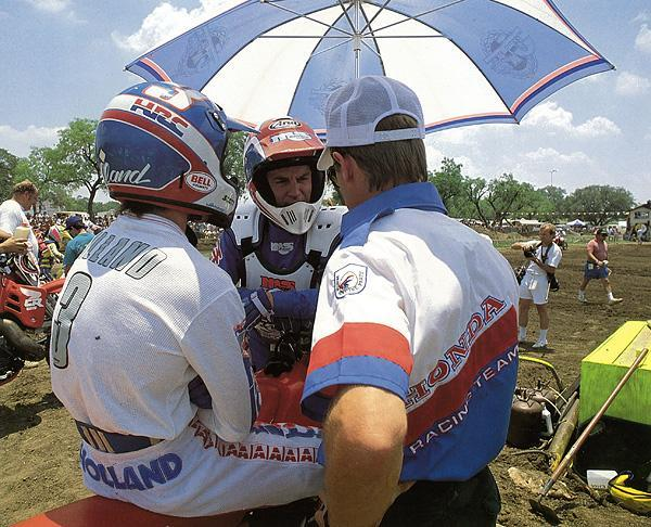 Team Honda riders George Holland and Guy Cooper (center) compare notes before a 125 National.