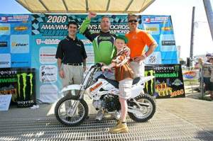 (Above) Monongahela's Ben Roberts poses on the new dirt bike he won at the American Motocross Festival, held last weekend at Steel City Raceway. The Kawasaki KLX110 was presented by Trib Total Media and the Pittsburgh Tribune Review, as well as Mosites Motorsports. Also pictured (from left to right) are: The Pittsburgh Tribune Review's Bill Fischer, Roberts' father, Rick, and Doug Mosites from Mosites Motorsports.