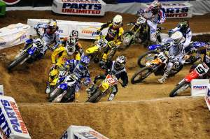 Stewart (7) gets the holeshot and knocks Ryan Dungey (behind Stewart) down in the process.