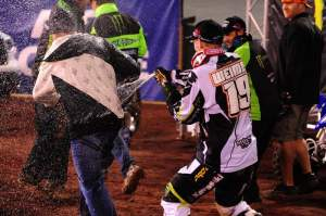Weimer douses trainer Randy Lawrence with champagne.
