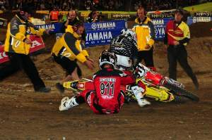 Points leader Chad Reed (1) went down with MCRMX's Tyler Bowers (911) before the first turn.