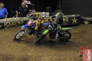 Once Stewart (1) took the lead, Villopoto (2) tried to pass him back and collided with him, but Stewart pulled away anyway.
