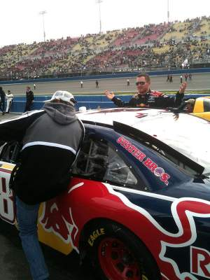 Travis Pastrana tries to take Brian Vickers' car for a joy-ride.