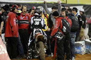 Canard is met by his team(s) and Fox's Chris Onstott (fists in the air) after the main.