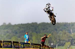 Canard is cheered on by a member of his team as he chases down Dean Wilson in the second moto.