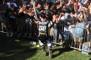 Canard climbed a fence to go spray champagne and high-five the fans who stayed through the podium ceremony.