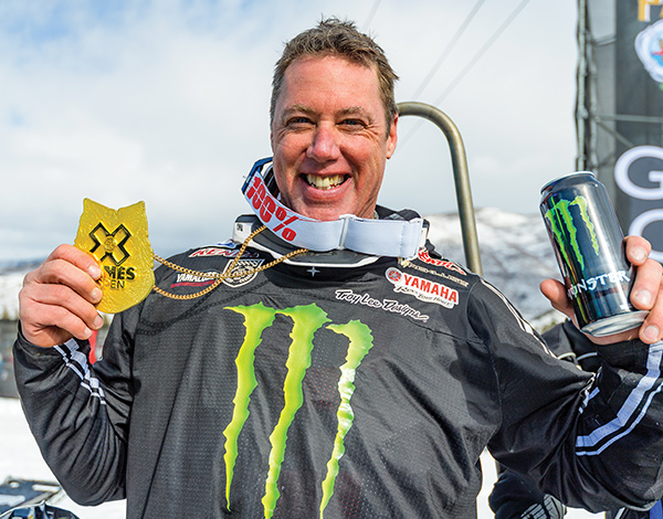 Pro motocross legend Doug Henry shows off his X Games gold medal in Para Snow BikeCross.