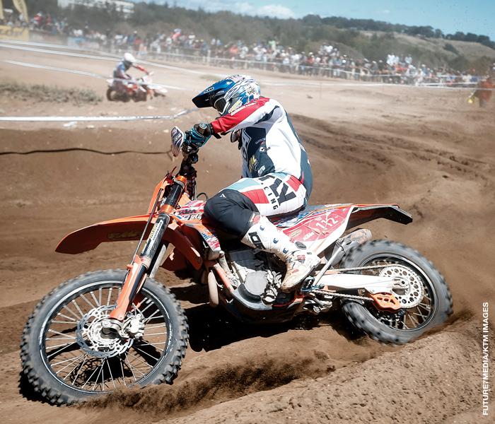 RacerX Supercross rider coming around a corner