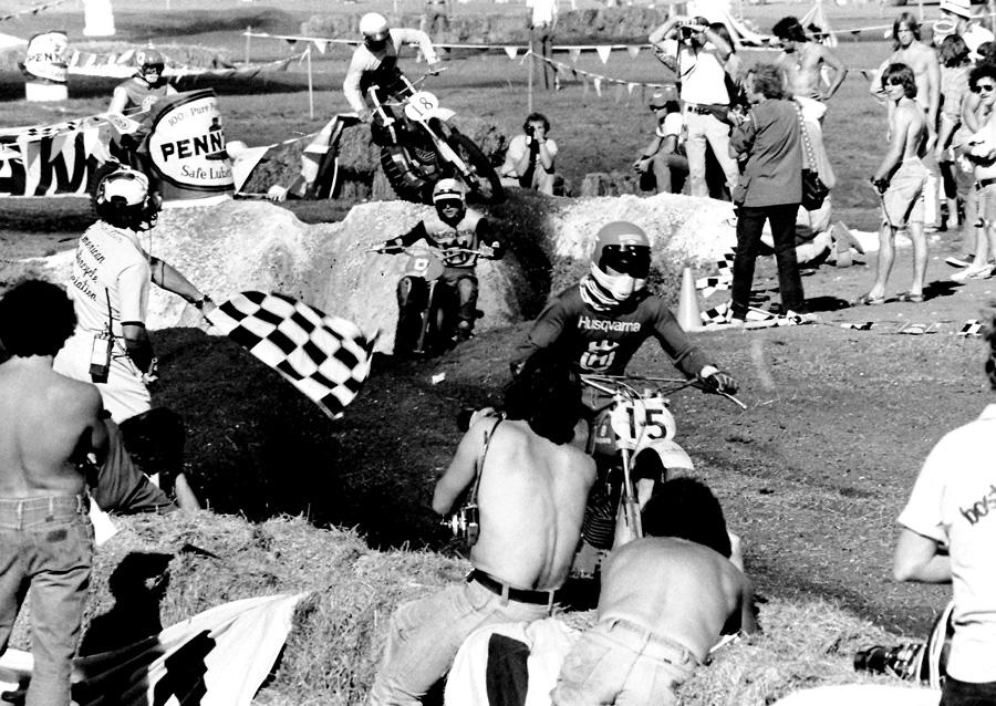 Team Husqvarna's Kent Howerton flashes across the checkered flag in the opening 250 moto of the '75 Daytona Supercross.