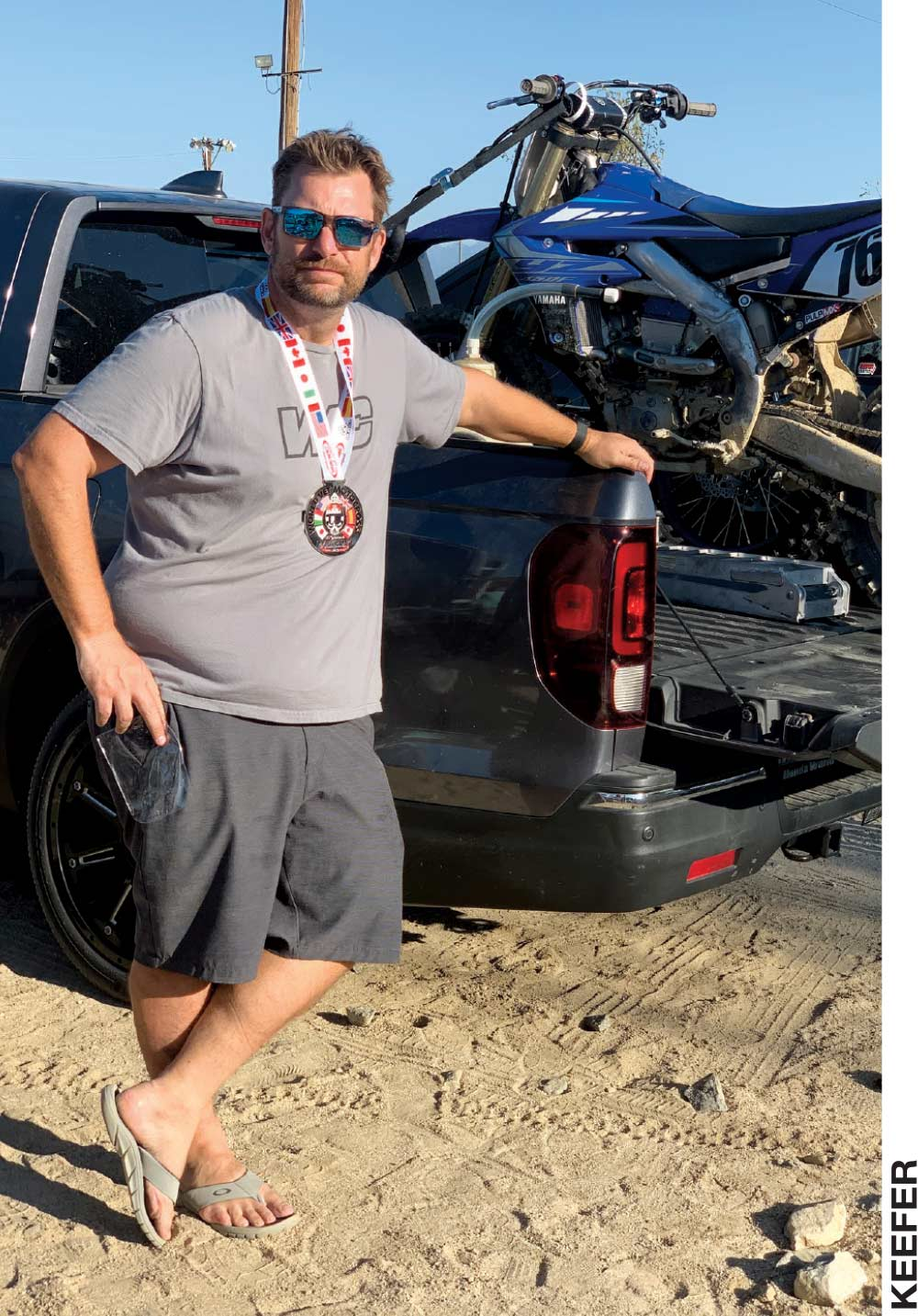 Matthes shows off his participation medal