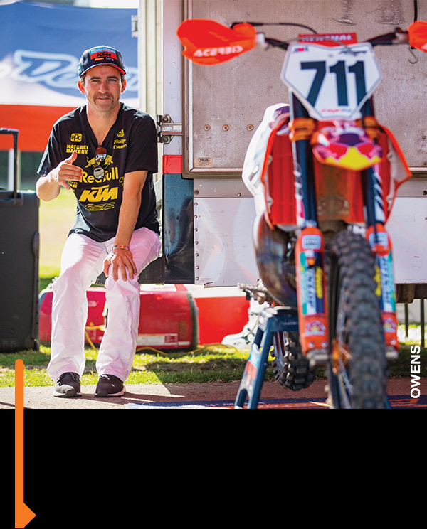 Mitchell Falk hanging on the TLD KTM tailgate.