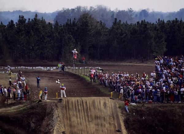 Erik Kehoe launching the finish line jump at Gatorback above Jeremy McGrath.